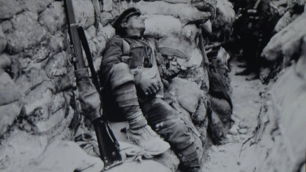 Soldier rests in trench