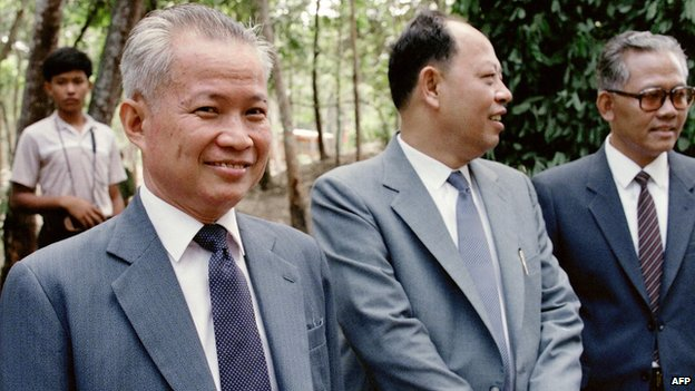Khieu Samphan, then-Vice-President of The Coalition Government of Democratic Kampuchea (CGDK), smiles in the Khmer Rouge stronghold of Dong Rek during a meeting with Chinese diplomats on 22 August, 1985