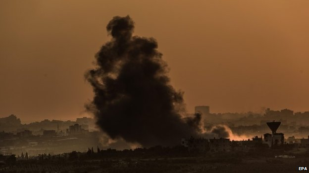 Smoke rises as a result of Israeli airstrike from the northern Gaza Strip neighborhood of Shejaeiya during sunset, 04 August