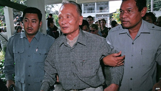 This photo dated 29 December 1998 shows Nuon Chea being helped by bodyguards on his arrival at a hotel in Phnom Penh