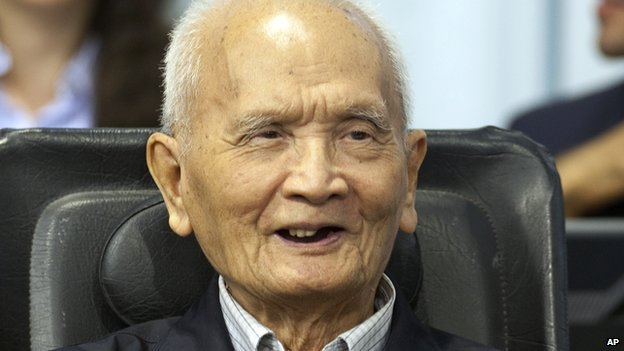 In this photo released by the Extraordinary Chambers in the Courts of Cambodia, Nuon Chea smiles before his final statements at the tribunal in Phnom Penh, Cambodia on 31 Oct 2013