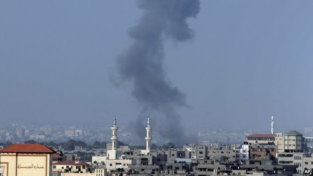 Smoke rises over Gaza City after an Israeli strike minutes before the time agreed for a preliminary 72-hour ceasefire, on Tuesday Aug, 5, 2014