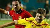 Manchester United's Juan Mata challenges Liverpool's Steven Gerrard