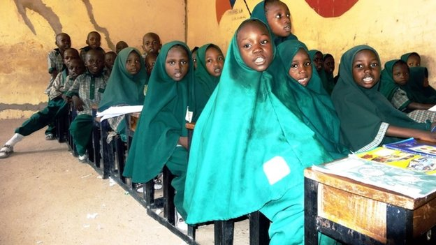 Children read from the Koran on 23 May  2014 in a classroom of the Future Prowess Islamic Foundation School in the north-eastern Nigerian city of Maiduguri