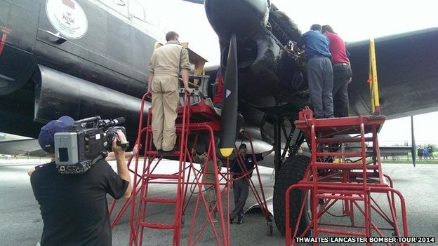 Engineers working on Lancaster bomber