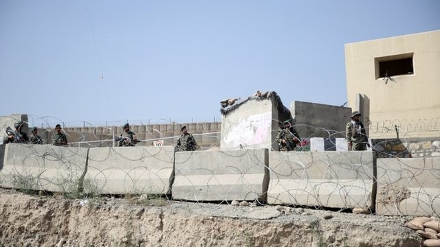 Afghanistan National Army soldiers stand guard at a gate to Camp Qargha, west of Kabul, Afghanistan