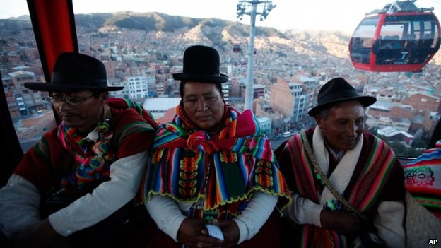Passengers inside the cable-car that links the city centre of La Paz with its neighbour El Alto, Bolivia, on 2 June 2014