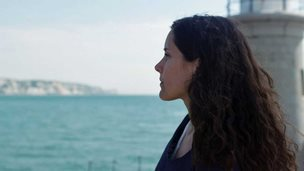 Actor Rachel Shelley looking at White Cliffs of Dover from Folkestone Pier