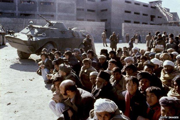 Afghans wait outside the Kabul central Pul-i-Charki prison 14 January 1980