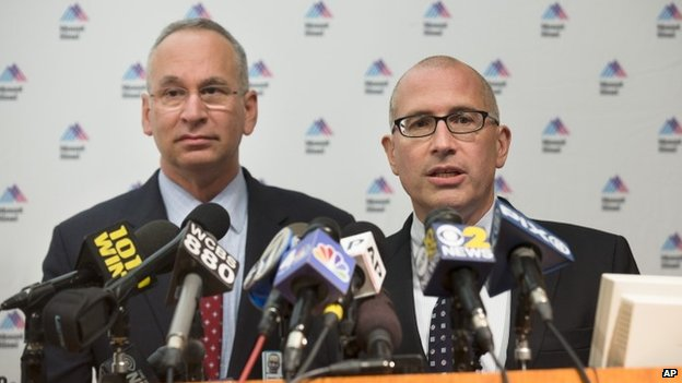 Jeremy Boal, Chief Medical Officer for the Mount Sinai Health System, right, speaks during a news conference alongside David Reich, President of Mount Sinai Hospital 4 August 2014