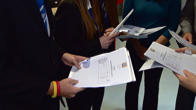 Students open their exam results