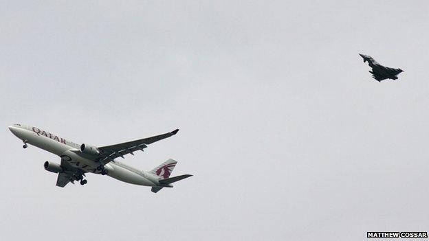 Plane being escorted