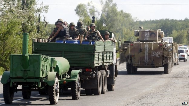 Ukrainian servicemen sit in an armoured personnel carrier (APC) near the eastern Ukrainian city of Slavyansk, in the region of Donetsk, on 5 August 2014.