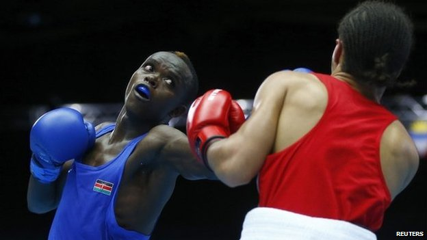 Benson Gicharu Njangiru (L) of Kenya and Tafari Ebanks of the Cayman Islands box during their men's bantamweight quarter-final bout at the 2014 Commonwealth Games in Glasgow, Scotland, 30 July 2014