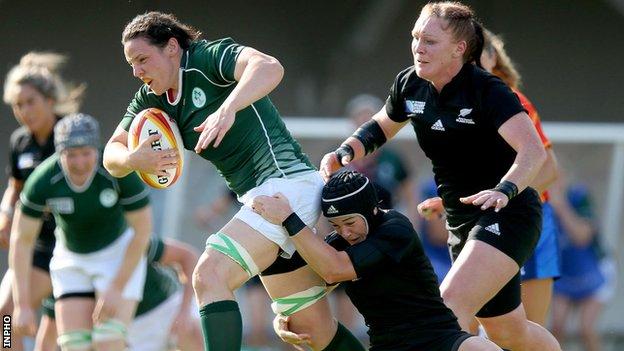 Ireland's Paula Fitzpatrick is tackled by Emma Jensen of New Zealand
