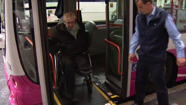 Philip McGrath getting off a bus using a ramp