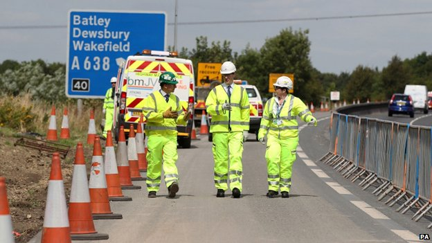 Chancellor George Osborne, centre, during a visit to a road improvement scheme near Wakefield, West Yorkshire, on the M1.