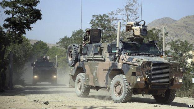 Nato military vehicles leave Camp Qargha (5 August 2014)