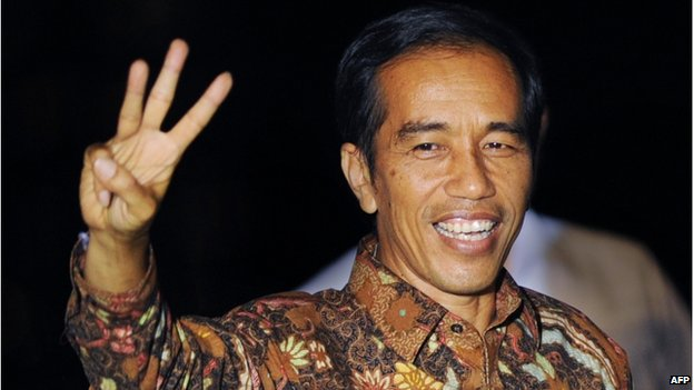 In this file photograph taken on 22 July 2014, Indonesian presidential candidate Joko Widodo gestures following his victory address in Jakarta's port district of Sunda Kelapa after the General Elections Commission declared him as winner in the presidential race against opponent Prabowo Subianto.