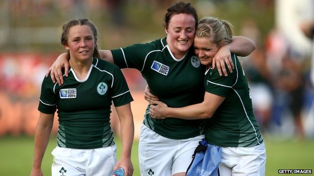 "Ashleigh Baxter, Ailis Egan and Vikki McGinn of Ireland embrace after their win during the IRB Women""s Rugby World Cup Pool B match between New Zealand and Ireland at the French Rugby Federation headquarters on August 5, 2014 in Paris, France."