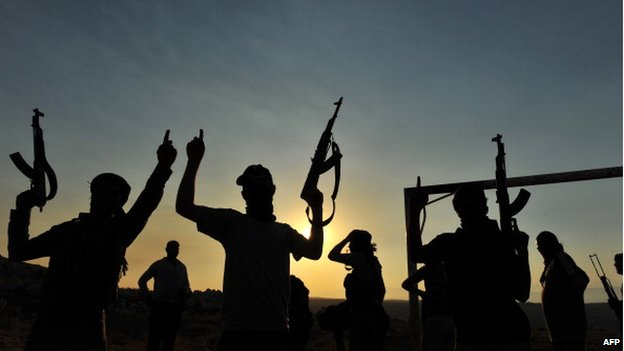 Members of Jihadist group Hamza Abdualmuttalib train near Aleppo on 19 July 2012.