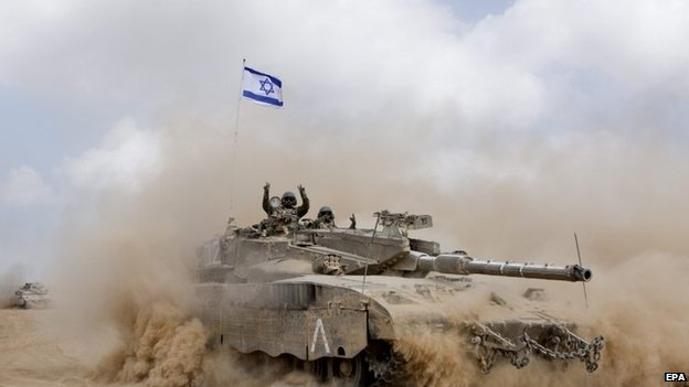 An Israeli Merkava tank moves in a large column back to a staging area further back from the border with the Gaza Strip on 5 August 2014.