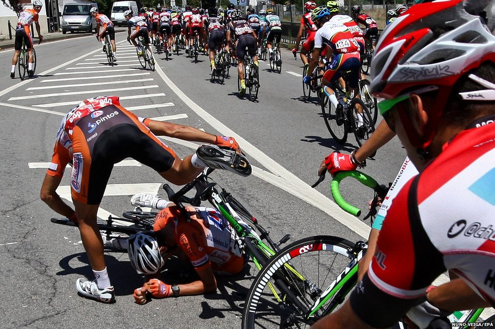 Edgar Pinto (left) and Hugo Sancho of the LA Antarte team crash during the 6th stage of the Cycling Tour of Portugal