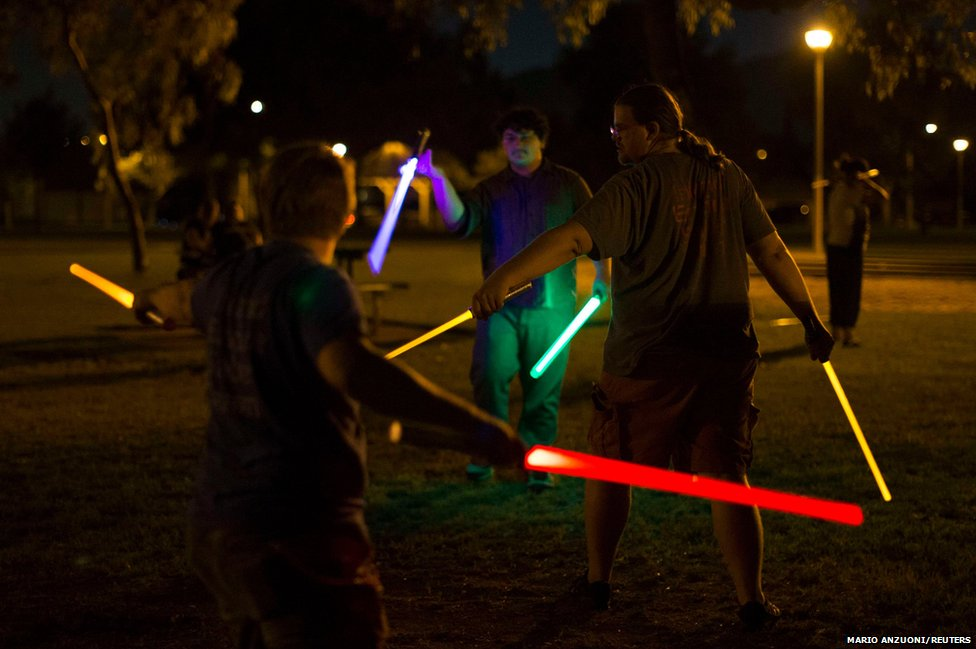 Enthusiasts practise their lightsaber moves