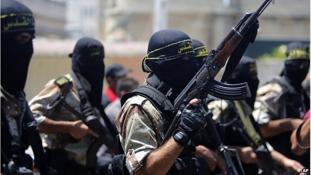 Masked militants of the Islamic Jihad group at the funeral of Shaaban Al-Dahdouh in Gaza City on 6 August 2014