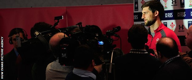 Luke Charteris faces a scrum of cameramen during a Wales media session