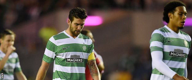 Charlie Mulgrew and Virgil van Dijk leave the field following Celtic's 2-0 defeat by Legia Warsaw