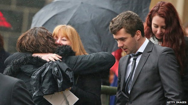 Mourners embrace as they leave after attending a national memorial service as Australians mourn the loss of all victims of Malaysia Airlines Flight MH17 at St. Patrick's Cathedral on 7 August, 2014 in Melbourne, Australia