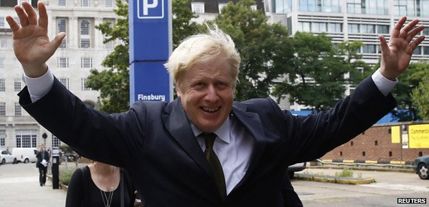Boris Johnson gestures as he leaves after giving a speech in London, during which he announced he would like to return to Westminster