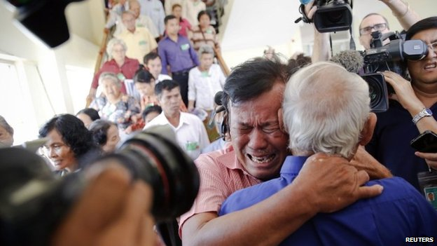 Soum Rithy, who lost his father and three siblings, reacts to the verdict in Phnom Penh on 7 August 2014