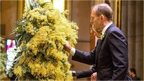 Australian Prime Minister Tony Abbott and wattle blossoms