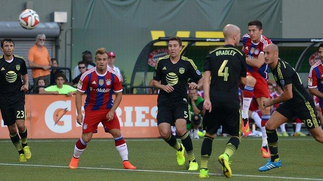 Bayern Munich striker Robert Lewandowski shoots at goal