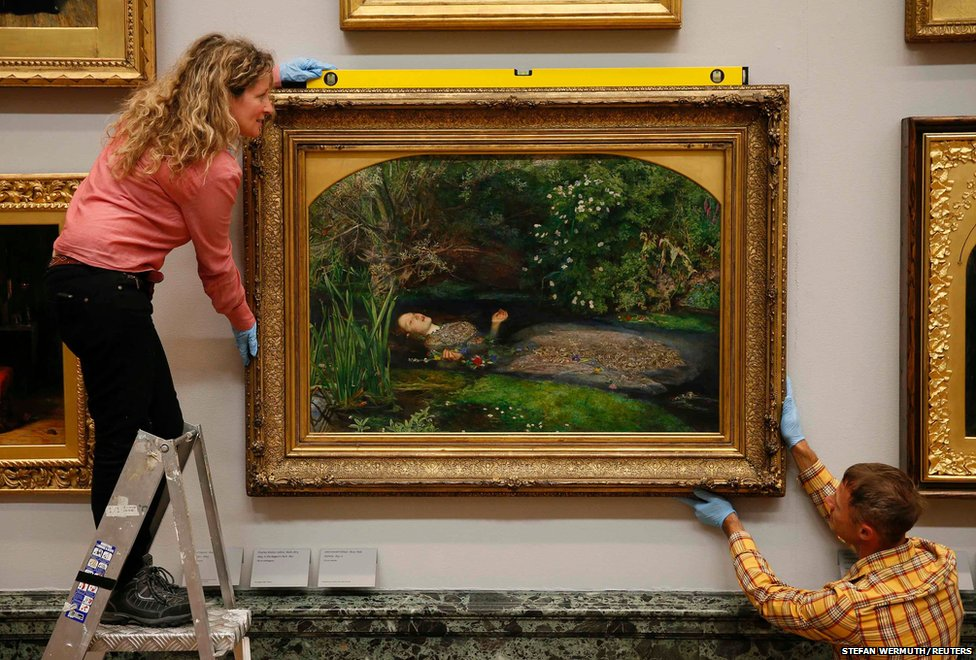 Staff pose with the painting Ophelia by John Everett Millais