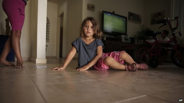 Israeli girl sits inside her home in Netiv Haasara, near the Gaza border (6 August 2014)