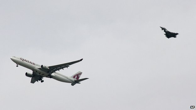 Qatar airliner being escorted by RAF