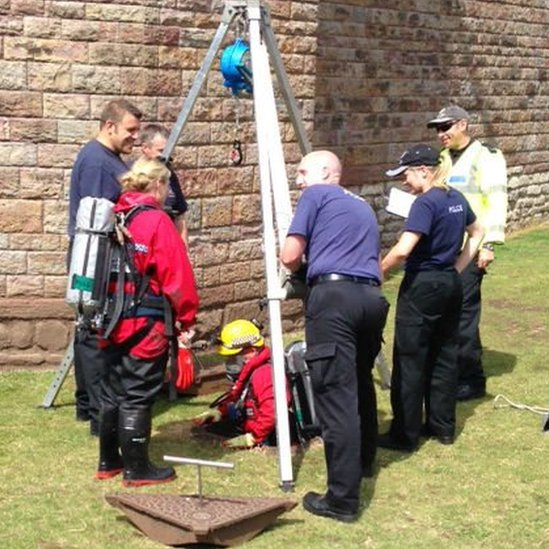 Police diver going down Cardiff Castle drain