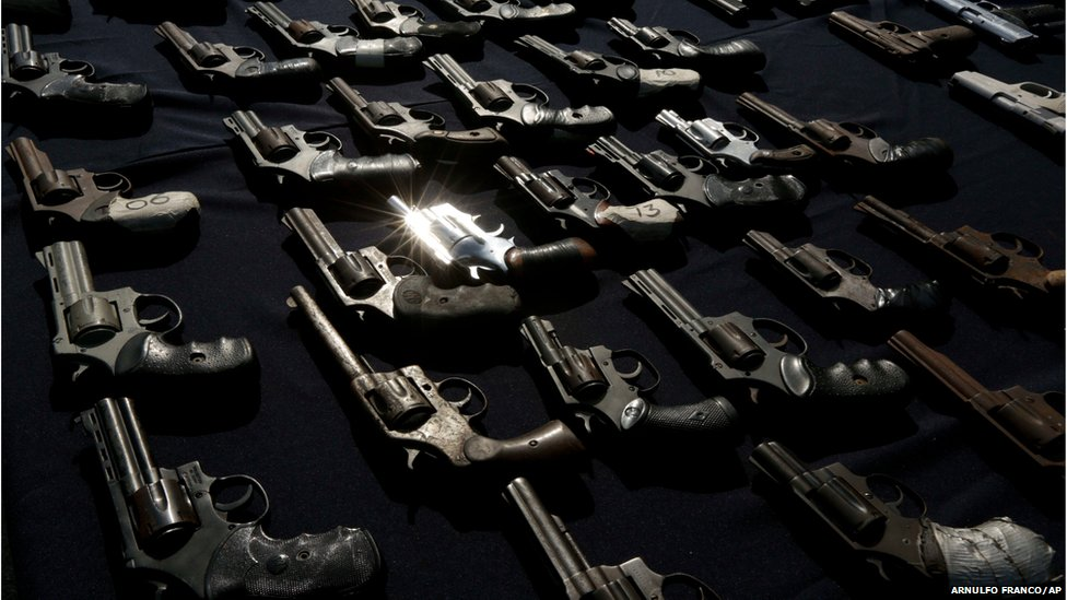Pistols are displayed by police before their destruction in Panama City