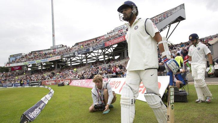 Murali Vijay and Gautam Gambhir walk out