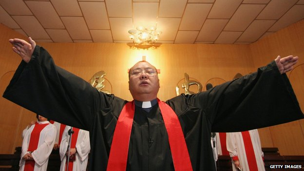 A Chinese priest during Mass