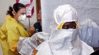 Staff treating Ebola patients at a hospital in Liberia