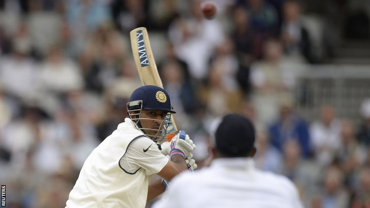 Mahendra Dhoni lifts the ball over Chris Jordan