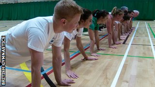 a row of people doing exercise