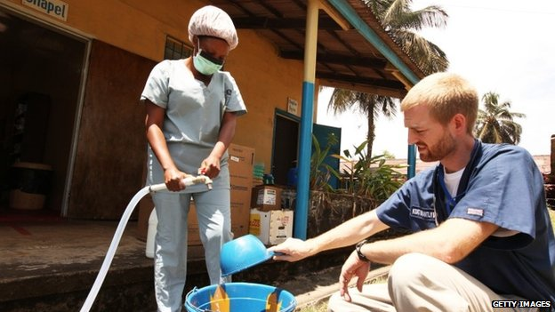 In this handout provided by Samaritan's Purse, Dr Kent Brantly, one of the two Americans who contracted Ebola, works at an Ebola isolation ward at a mission hospital outside of Monrovia, Liberia.