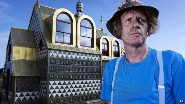 Grayson Perry in front of the chapel in Wrabness