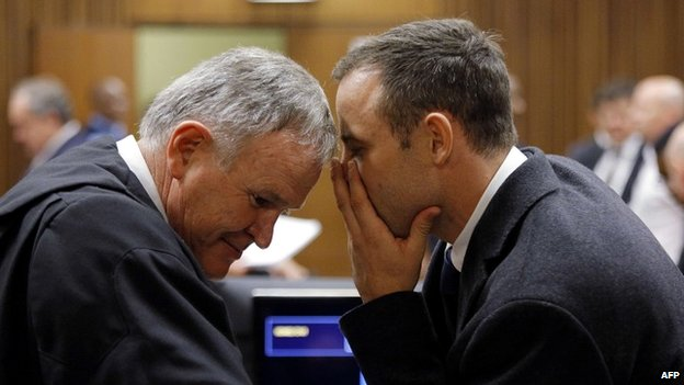 Oscar Pistorius speaks to his main defence lawyer, Barry Roux - 4 March 2014