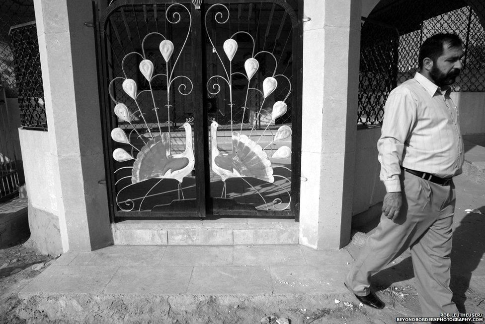 Tawus Maleke Peacock Angel shown on gates to a shrine